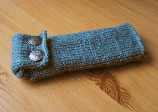 knitted pencil case made of dark green wool with two metal buttons