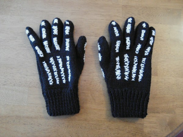 two skeleton gloves full