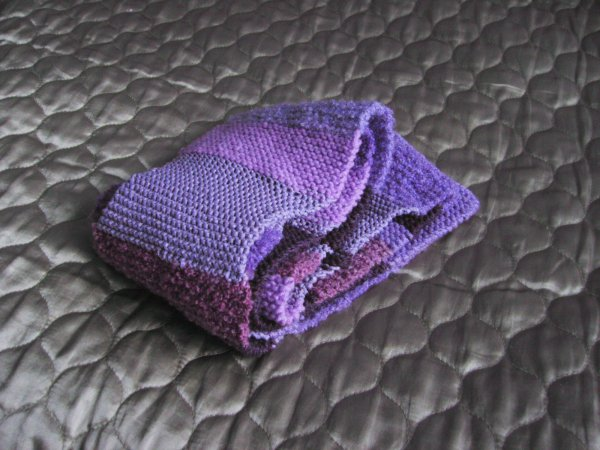 a stripey purple scarf with many different textures and shades