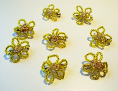 Small brooches with yellow beads