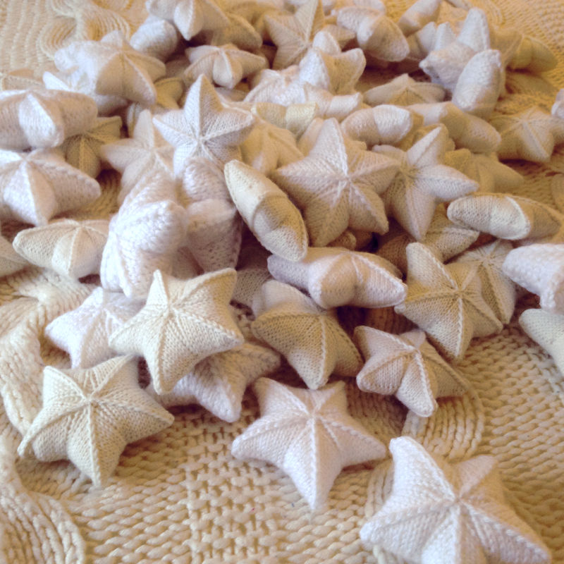 White and cream knitted stars, dozens and dozens of them
